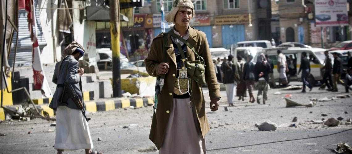 ©Reuters Houthi fighter guards a Sana'a street